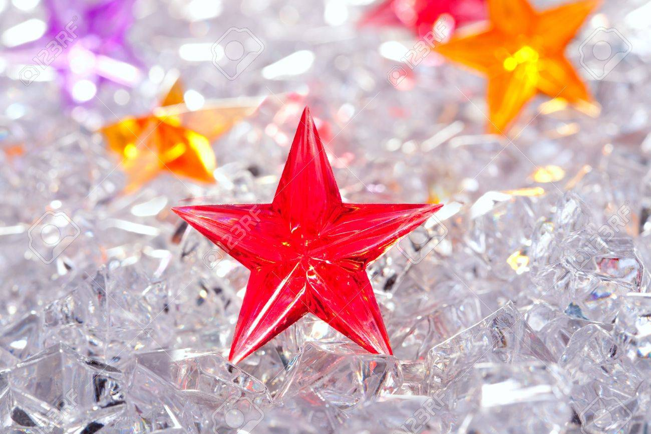 christmas red glass star on winter ice background Stock Photo - 10742996
