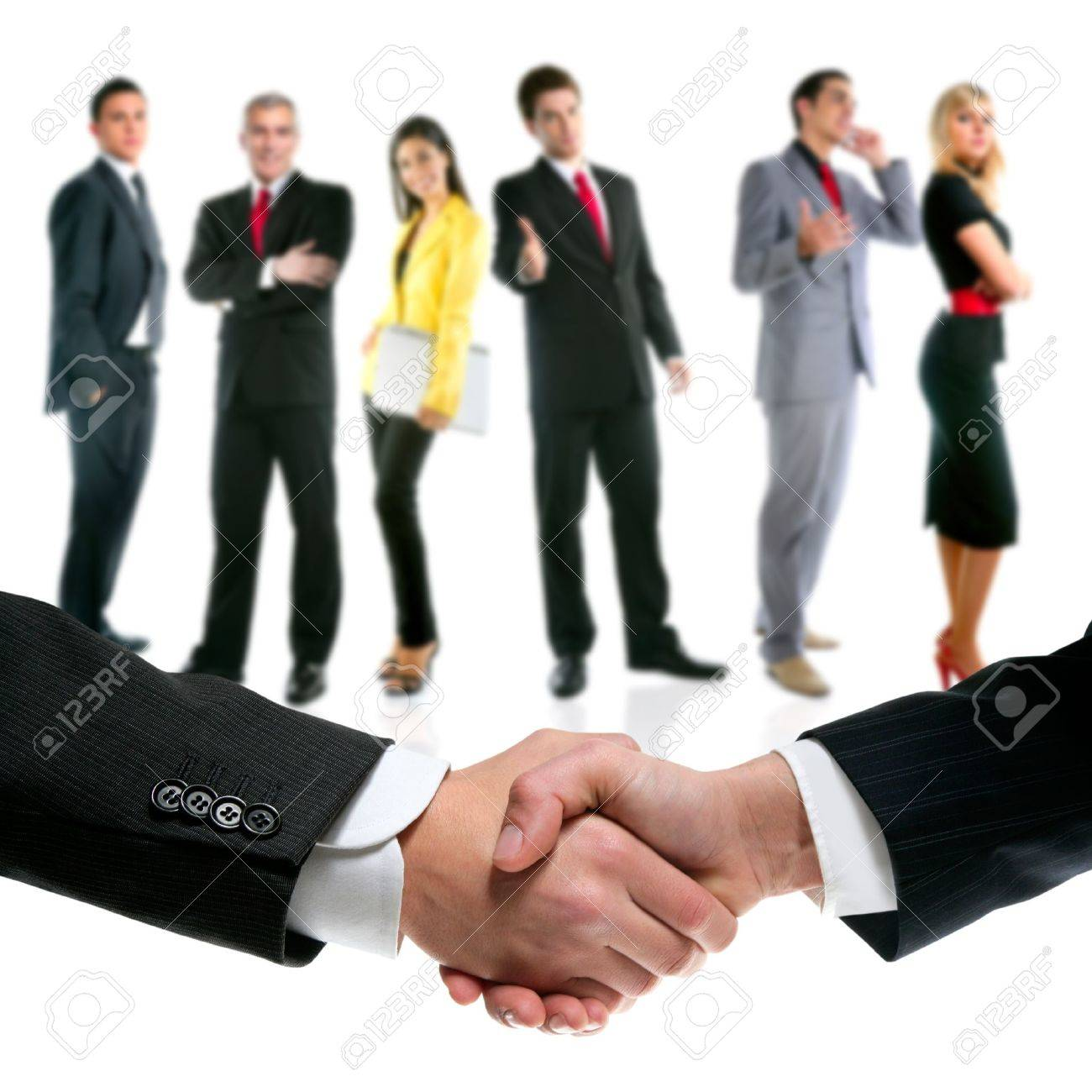 business people handshake with company team in background Stock Photo - 10772027