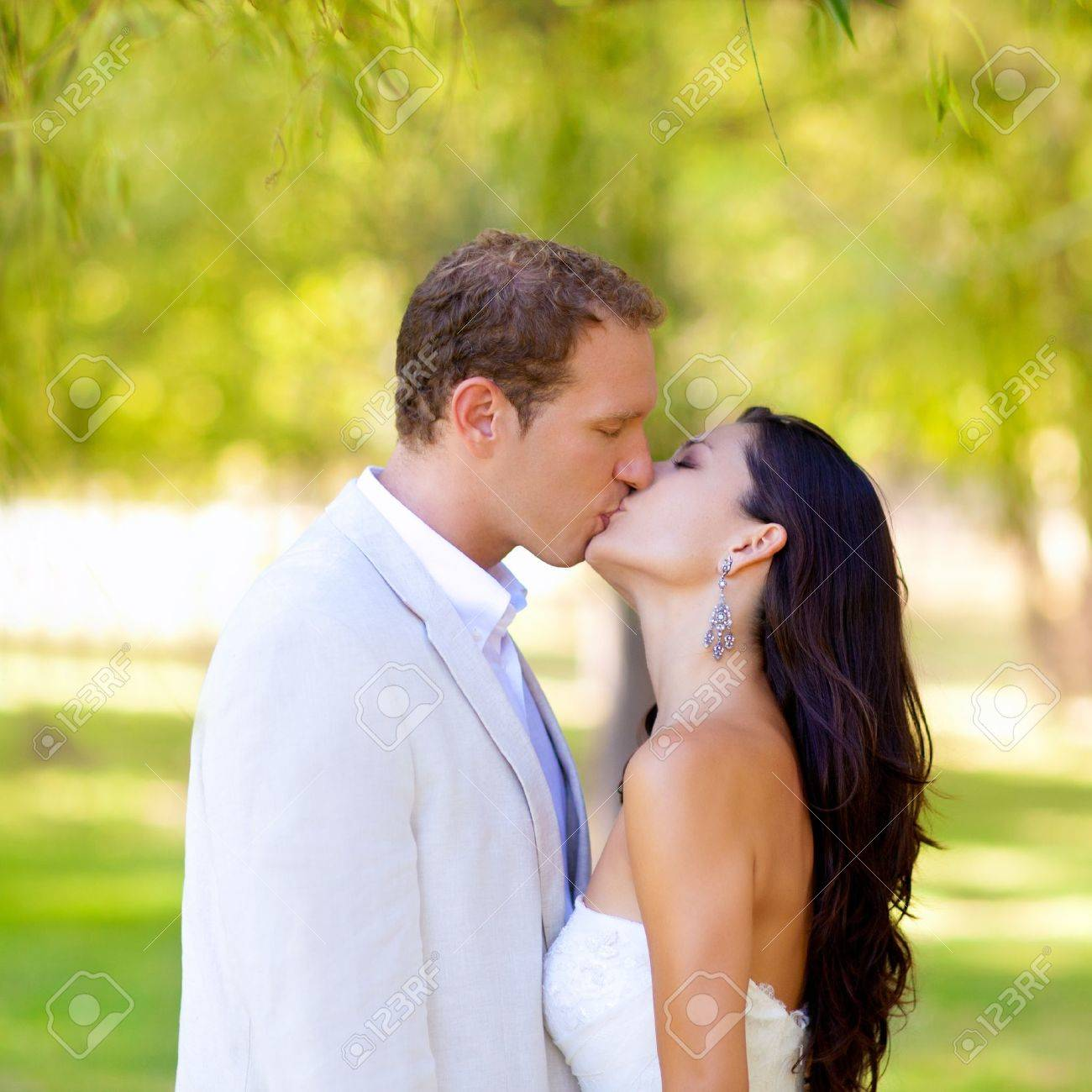 couple happy in love kissing in the park under the trees Stock Photo - 11149567