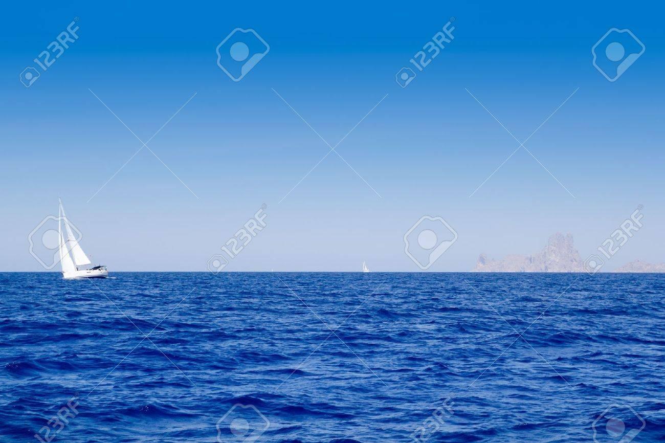 Ibiza Es Vedra and sailboat in blue mediterranean sea Stock Photo - 11201835