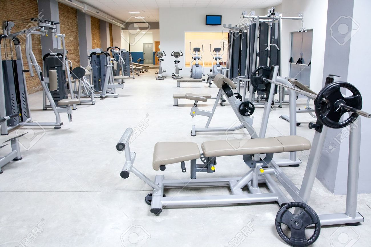Fitness club gym with sport equipment modern interior Stock Photo - 11982242