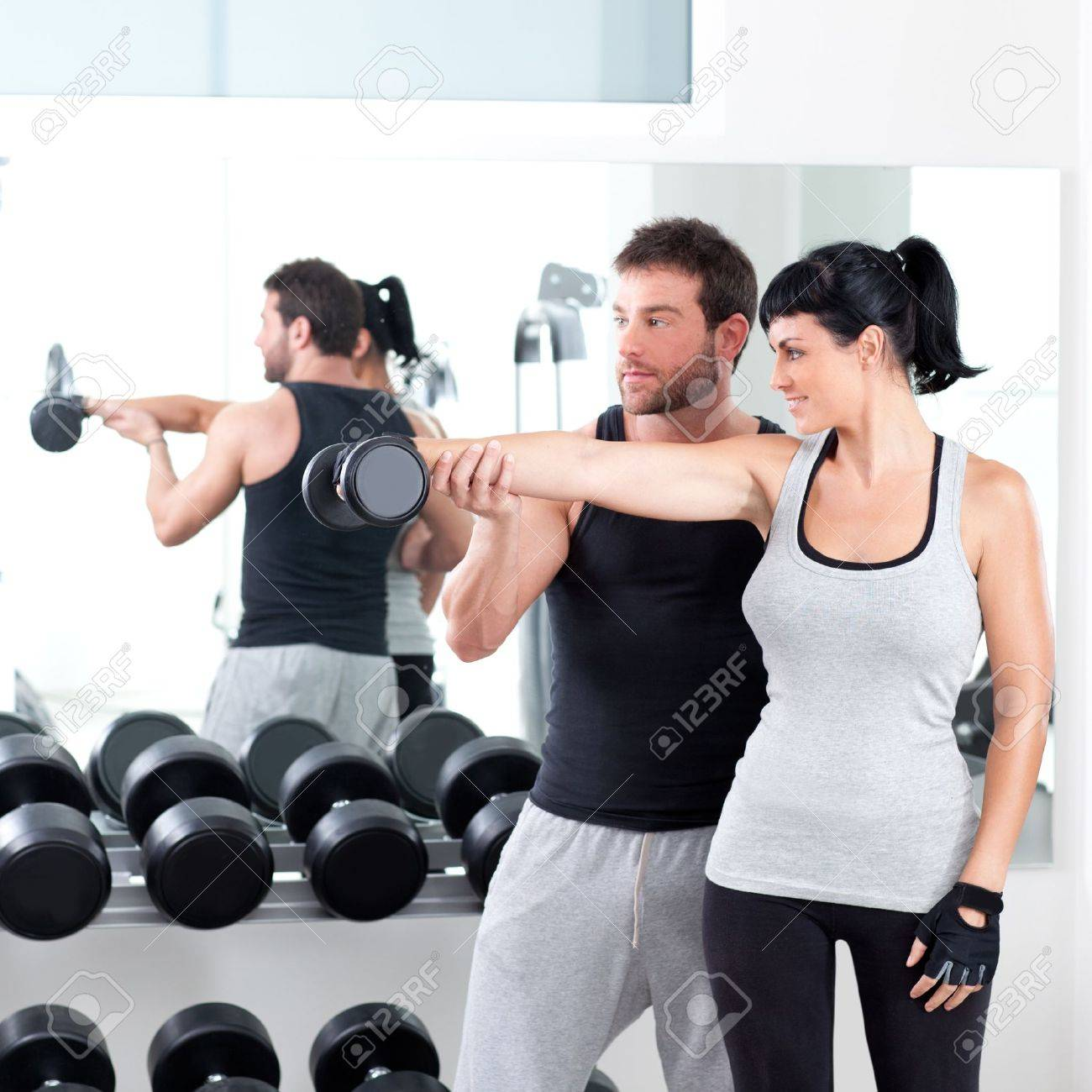 gym woman personal trainer man with weight training equipment Stock Photo - 11982052