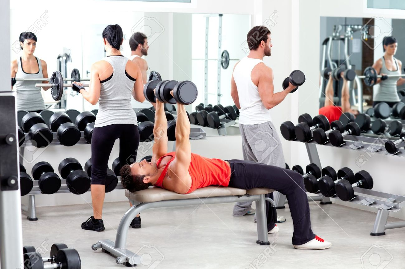 group of people in sport fitness gym weight training equipment indoor Stock Photo - 11982249