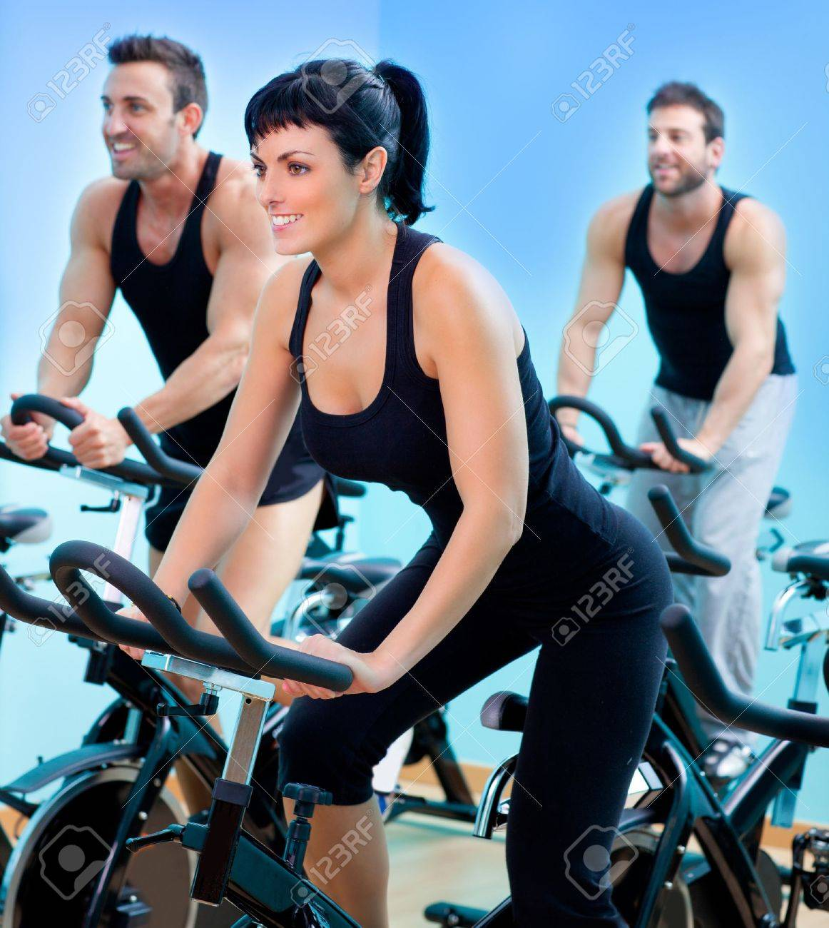 Stationary spinning bicycles fitness girl in a gym sport club Stock Photo - 11982237