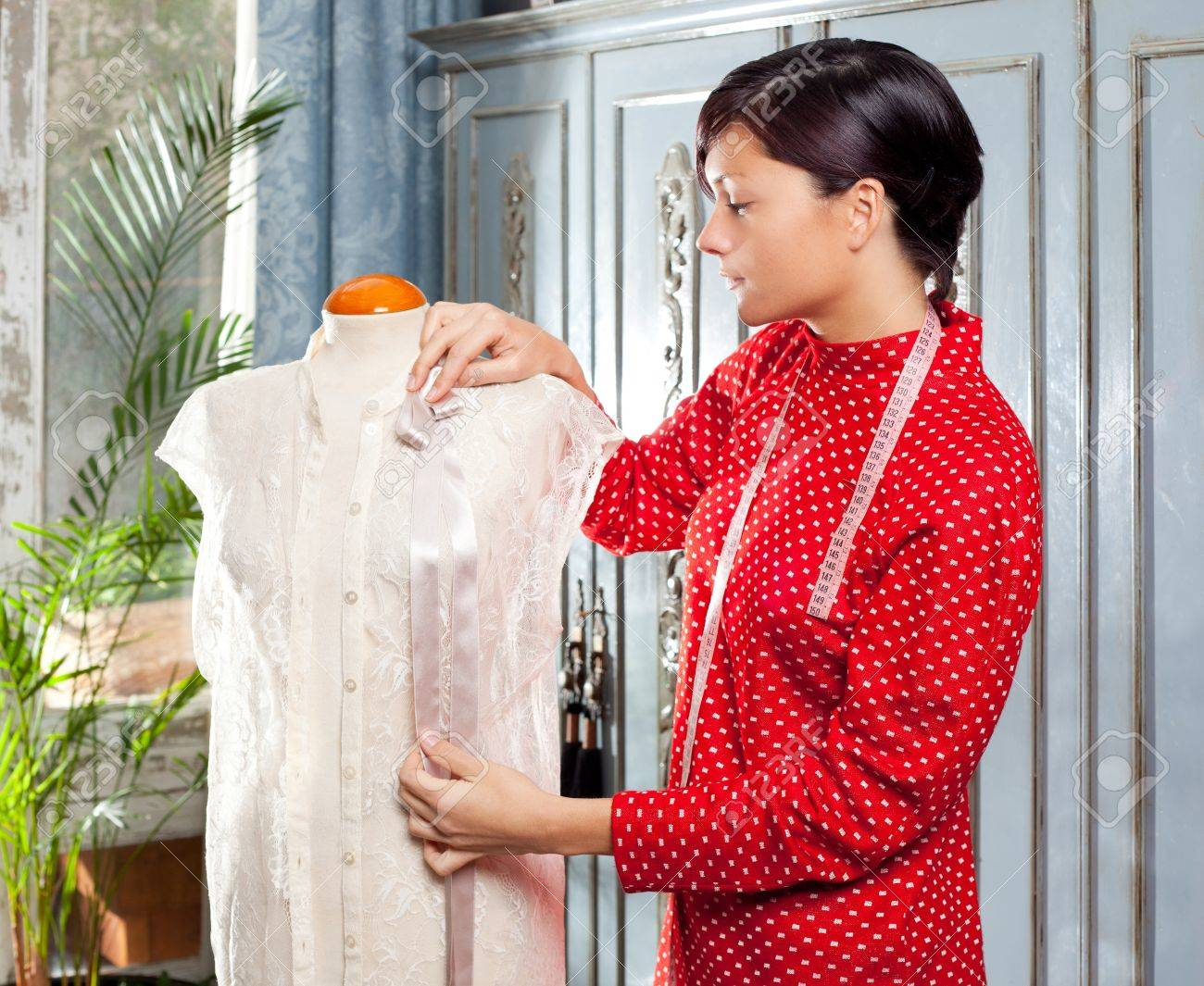 Dressmaker with mannequin as professional fashion designer Stock Photo - 12148095