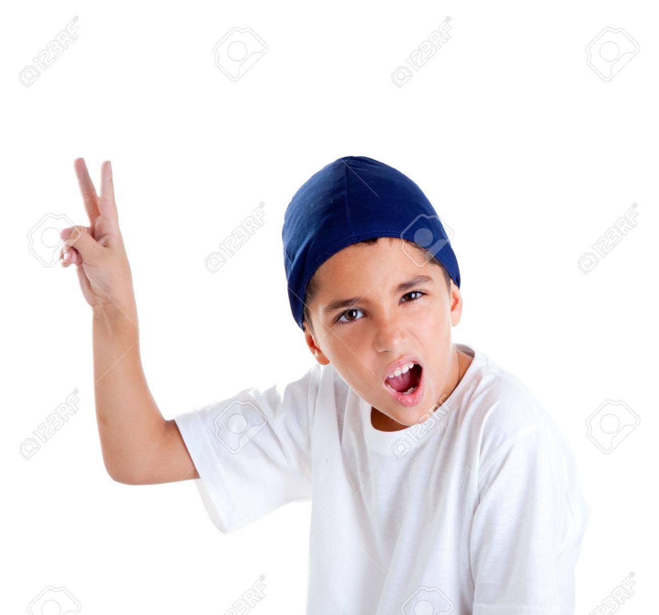 b8f7e21930e41e Blauwe pet kind jongen met overwinning handgebaar portret geïsoleerd op wit  Stockfoto - 12382366