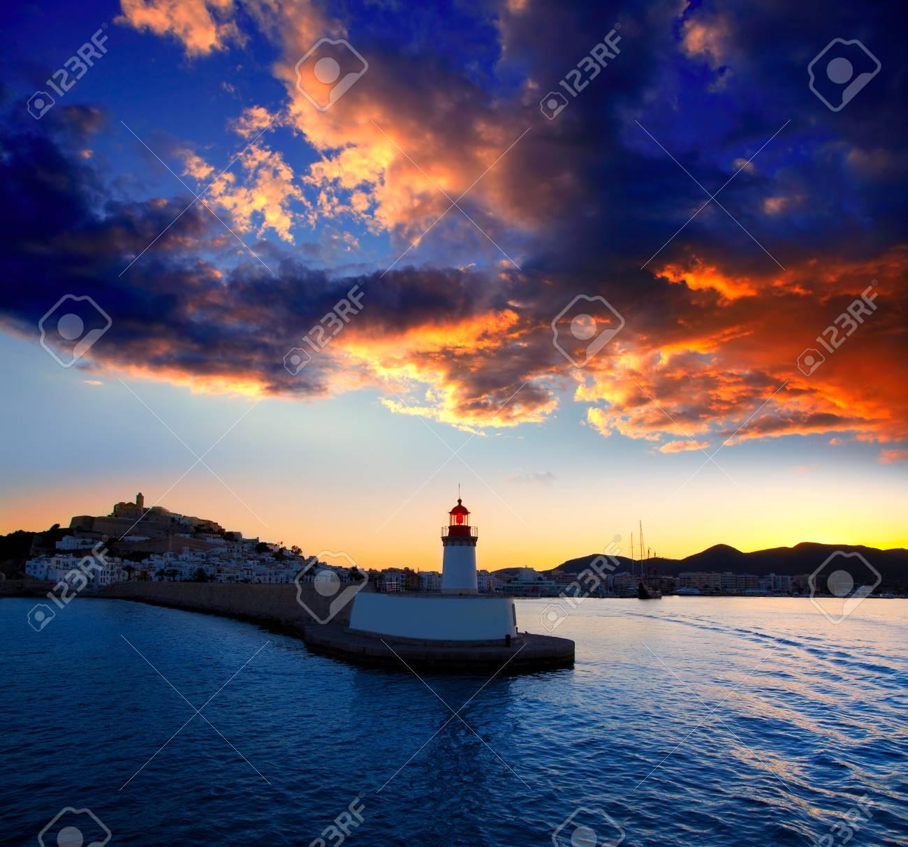 Eibissa Ibiza town sunset from red lighthouse beacon in port Stock Photo - 14266236