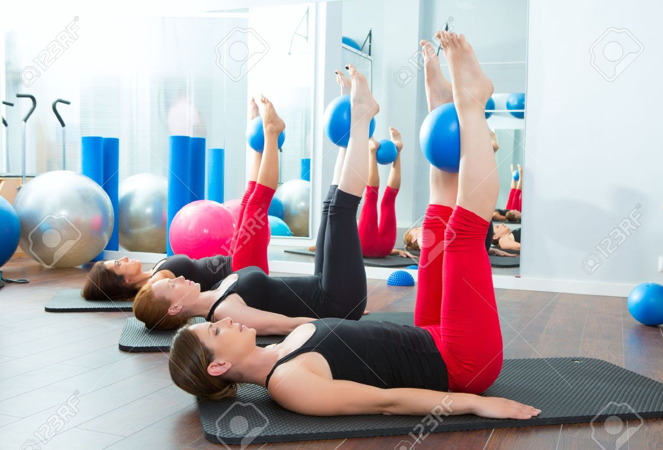 aerobics pilates women with yoga balls in a row on fitness classaerobics pilates women with yoga balls in a row on fitness class stock photo 15444292