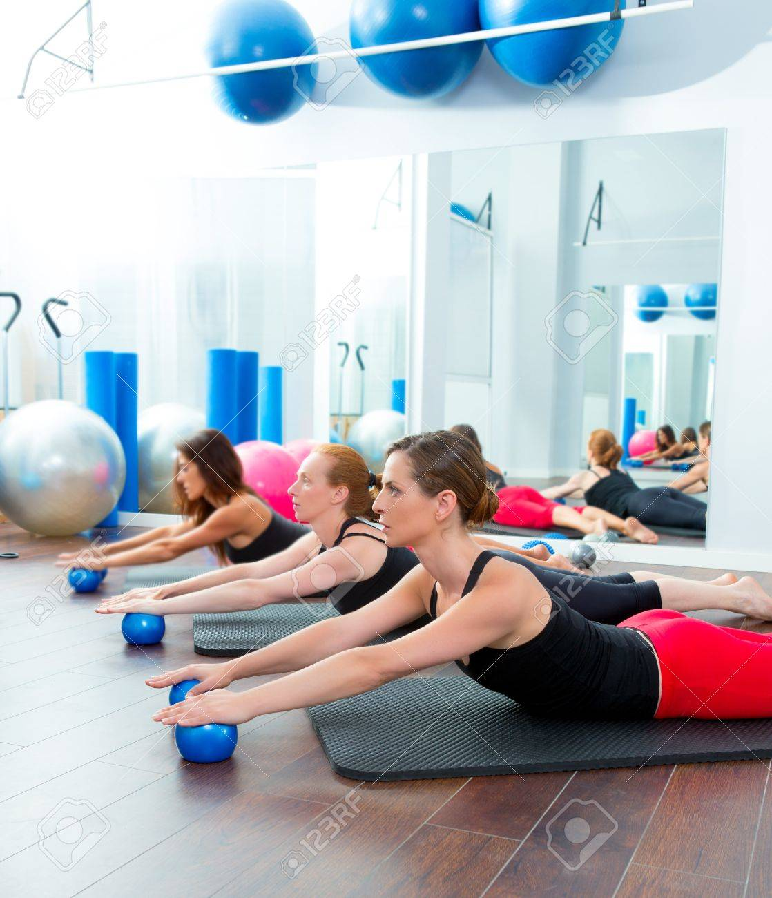 aerobics pilates women with toning balls in a row on fitness stockaerobics pilates women with toning balls in a row on fitness class stock photo 15444279