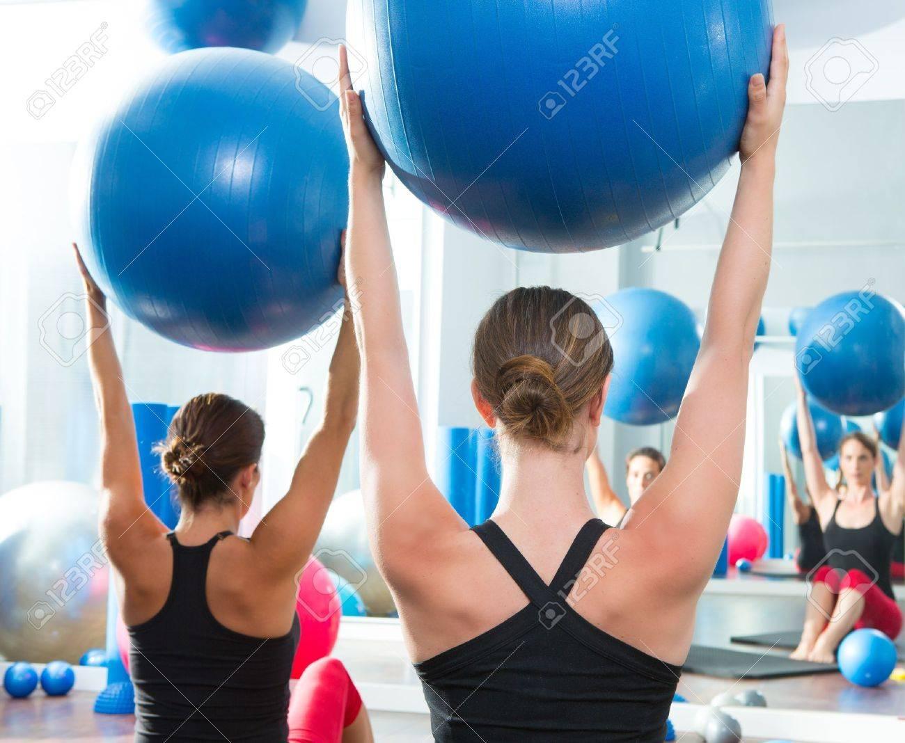 Blue stability ball in women Pilates class rear mirror view Stock Photo - 15444294