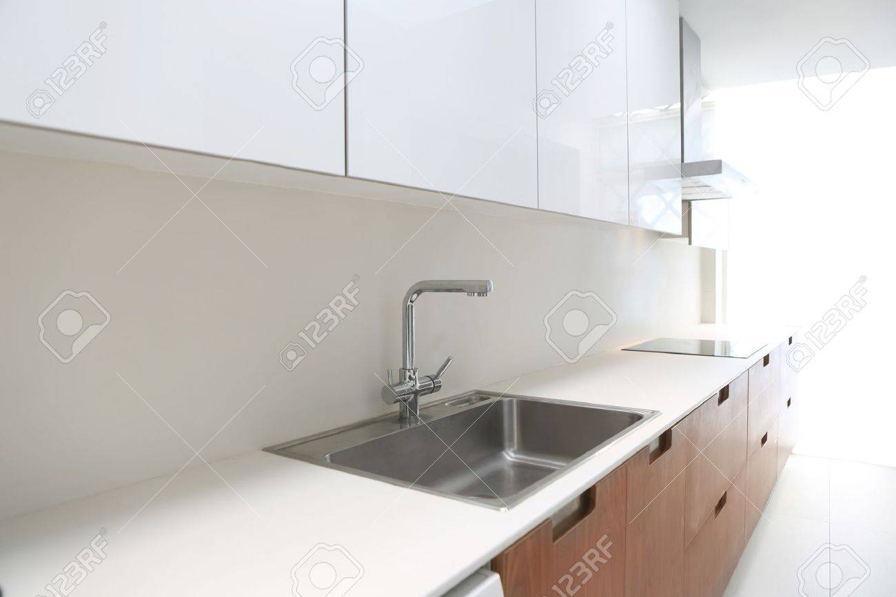 Actual modern kitchen in white and walnut wood interior house Stock Photo - 15901422
