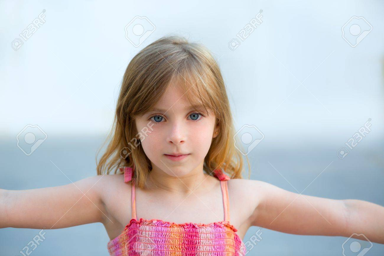 Blond kid girl open arms in outdoor with sundress Stock Photo - 15902958
