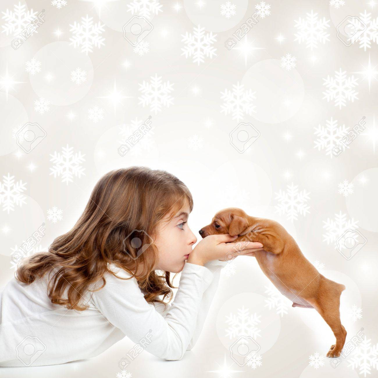 christmas snowflakes with children girl hugging a puppy brown dog Stock Photo - 15903112