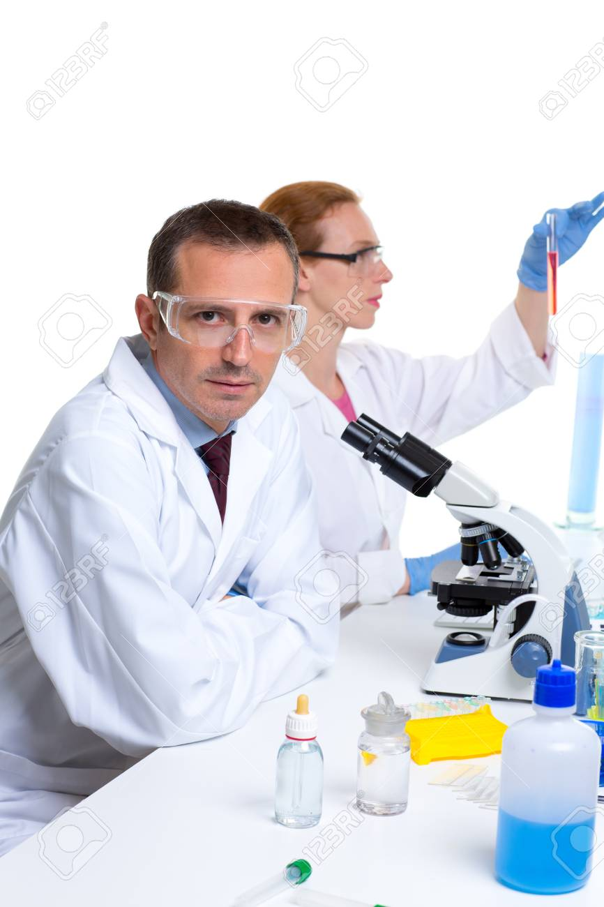 laboratory with two scientist working with test tubes flask and microscope Stock Photo - 16651402