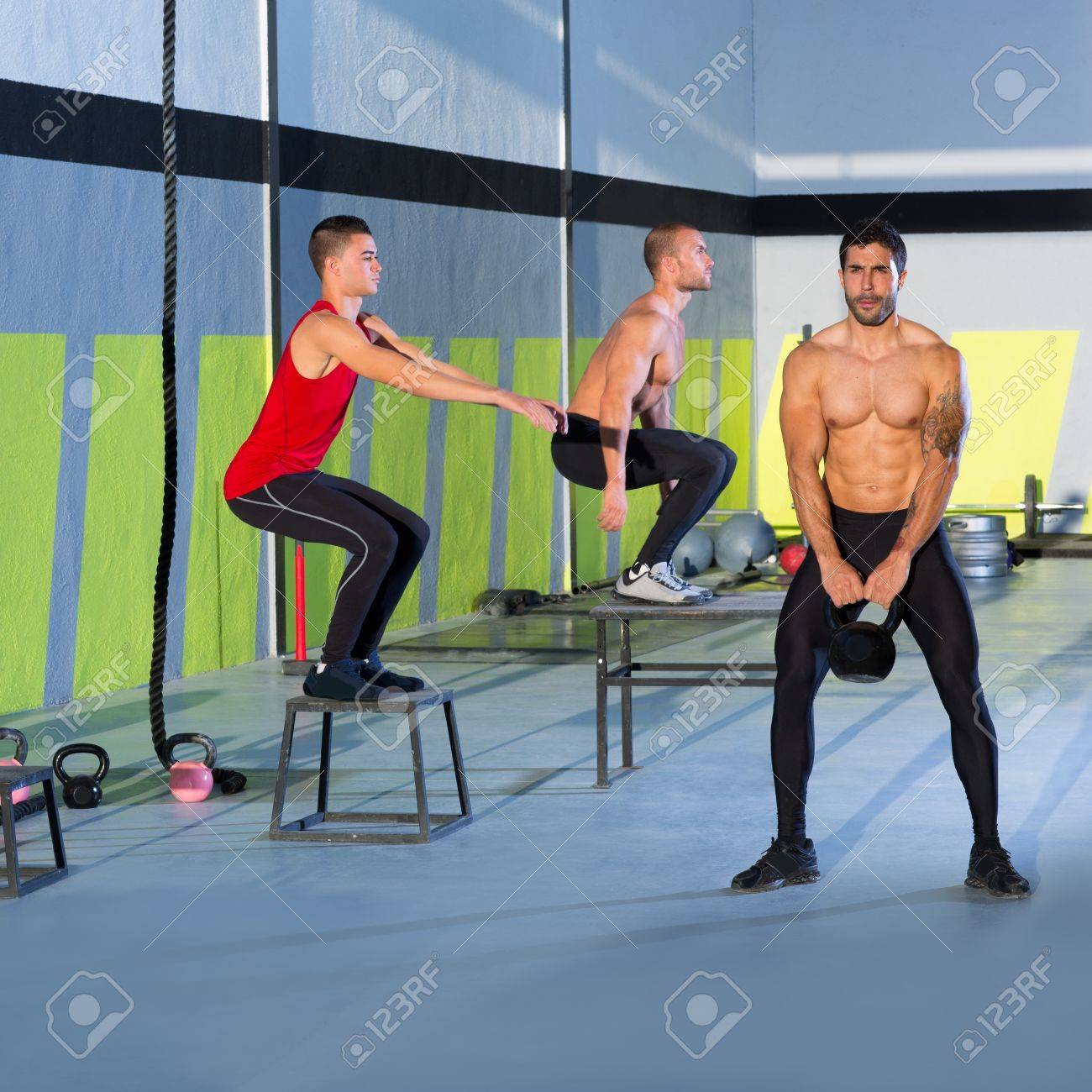 Crossfit box jump people group and kettlebell man at gym Standard-Bild - 17050620