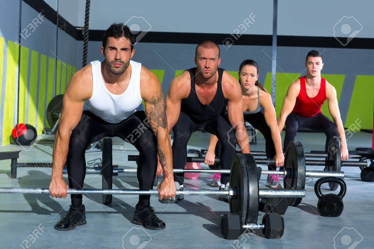 Gym Group With Weight Lifting Bar Workout In Crossfit Exercise Stock Photo