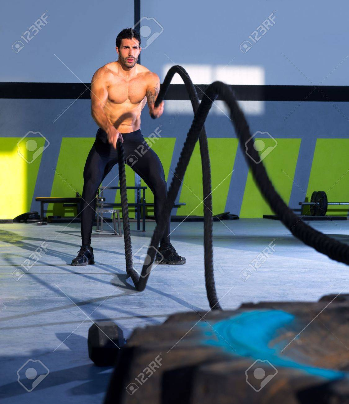 Crossfit battling ropes at gym workout from big tires Standard-Bild - 17050623