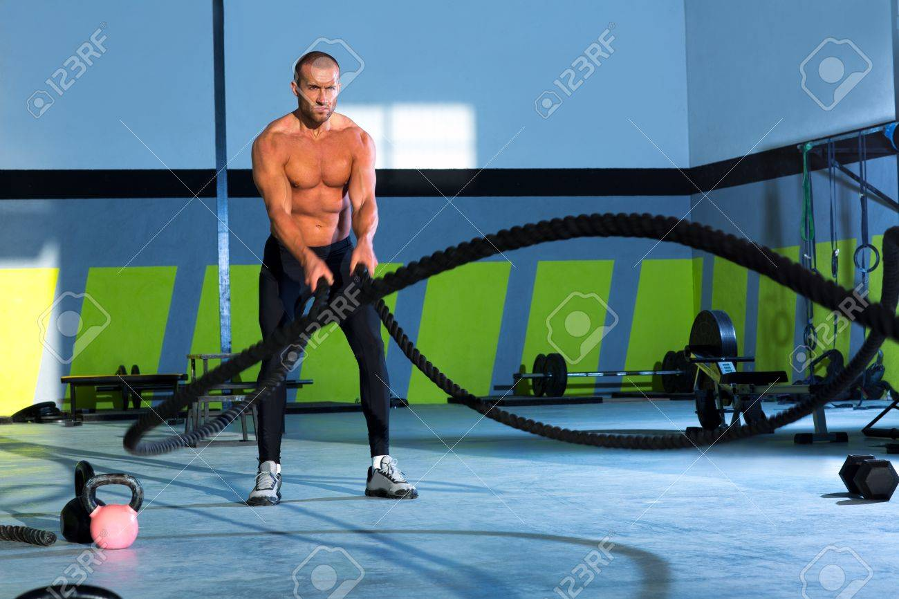 Crossfit battling ropes at gym workout fitness exercise - 17050547