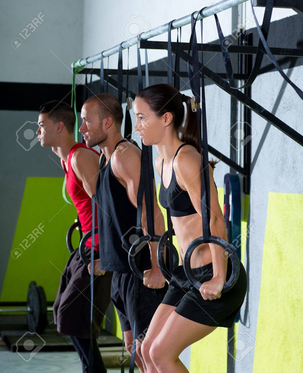 Crossfit dip ring group workout at gym dipping in a row exercise Stock Photo - 17050640