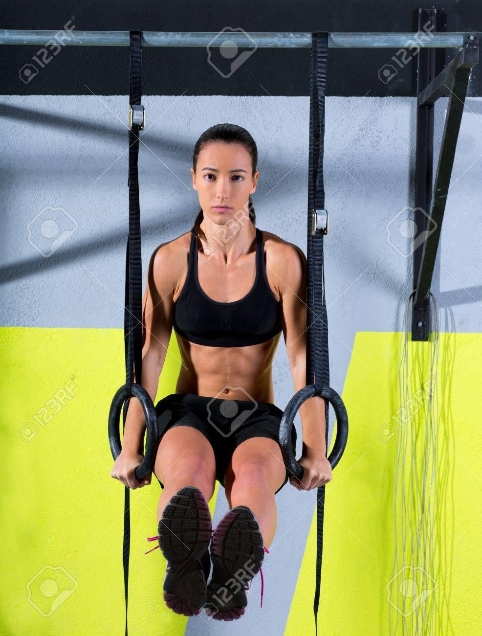Crossfit dip ring woman workout at gym dipping exercise Standard-Bild - 17050554