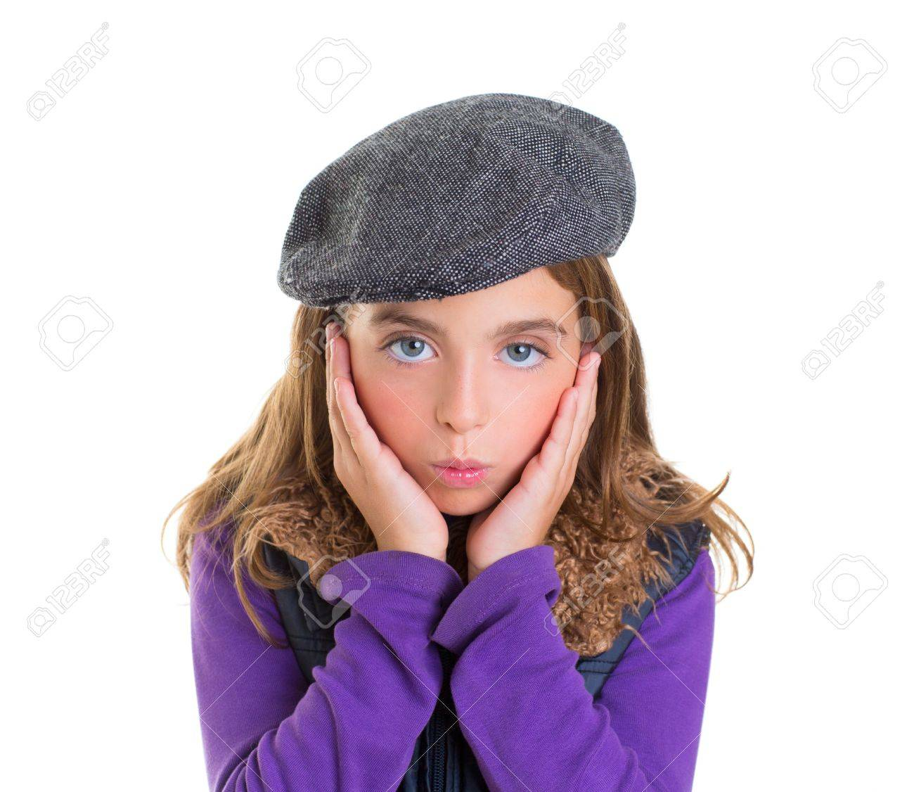 Child kid girl face expression of surprise hands in face on white with winter fashion cap Stock Photo - 17237637