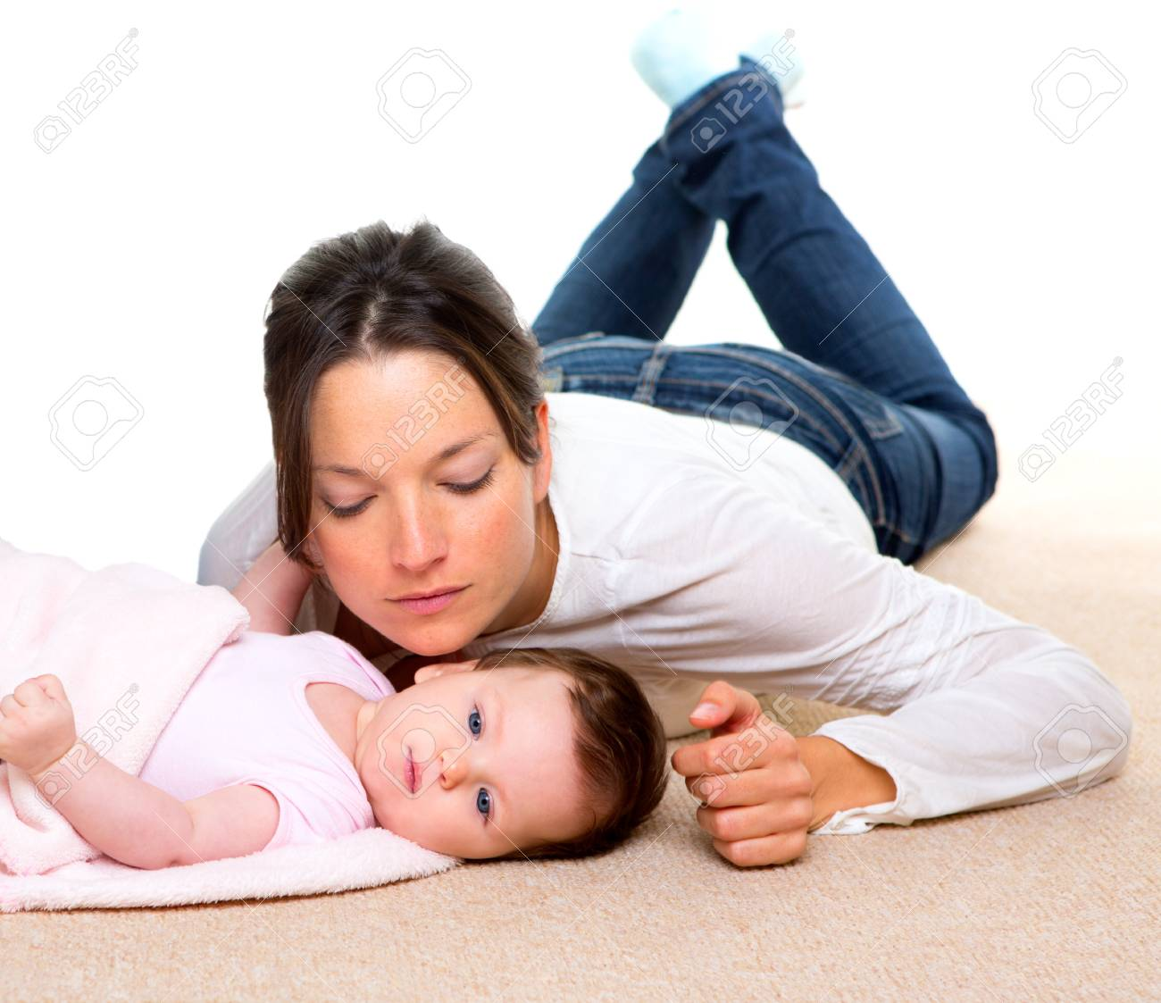 Baby and mother lying on beige carpet together and white background Stock Photo - 17237682