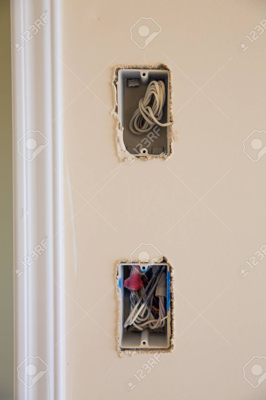 electrical box for switch and plug with wires while new house rh 123rf com Doorbell Transformer Doorbell Wiring Schematic