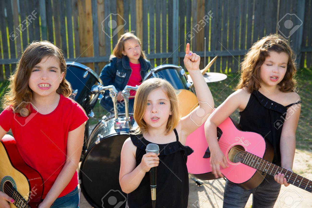 blond kid singer singing playing live band in backyard