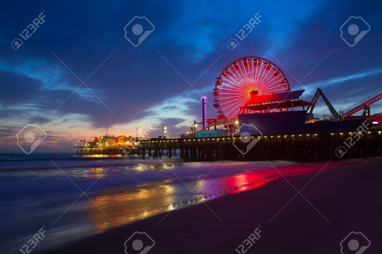 Santa Monica California sunset on Pier Ferrys wheel and reflection on beach wet sand - 22395009