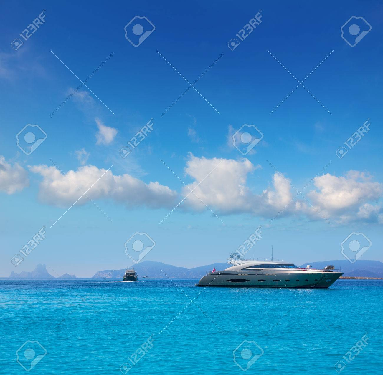 Formentera boats with Ibiza Es Vedra in Balearic islands - 22717890