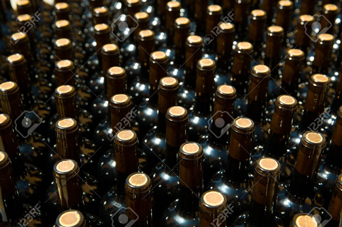 Wine bottles in a row as a pattern with cork  in Mediterranean winery Stock Photo - 23352771