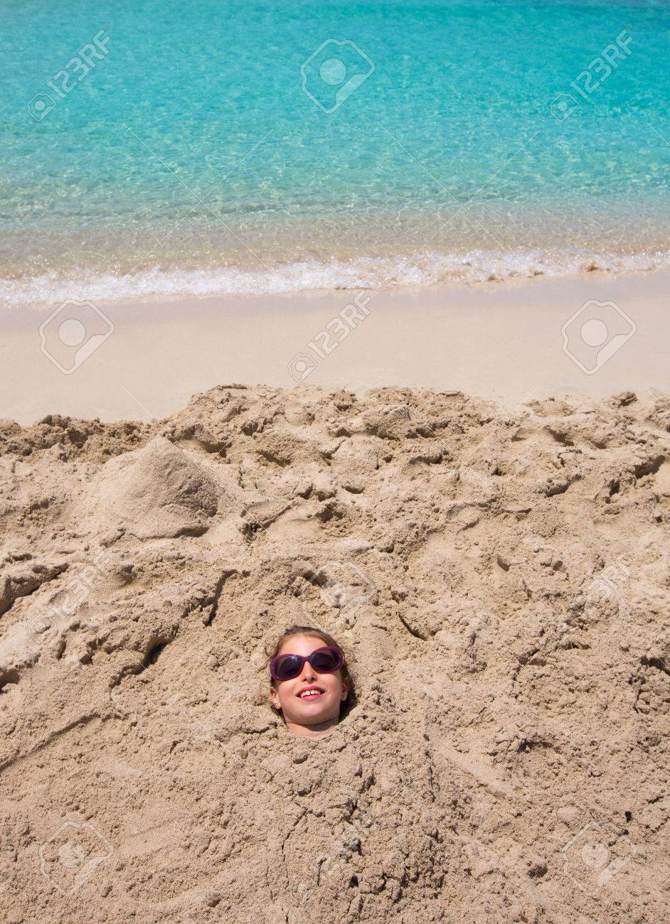Funny Kid Girl Playing Buried In Beach Sand Smiling With Sunglasses Stock Photo Picture And Royalty Free Image Image 23997407