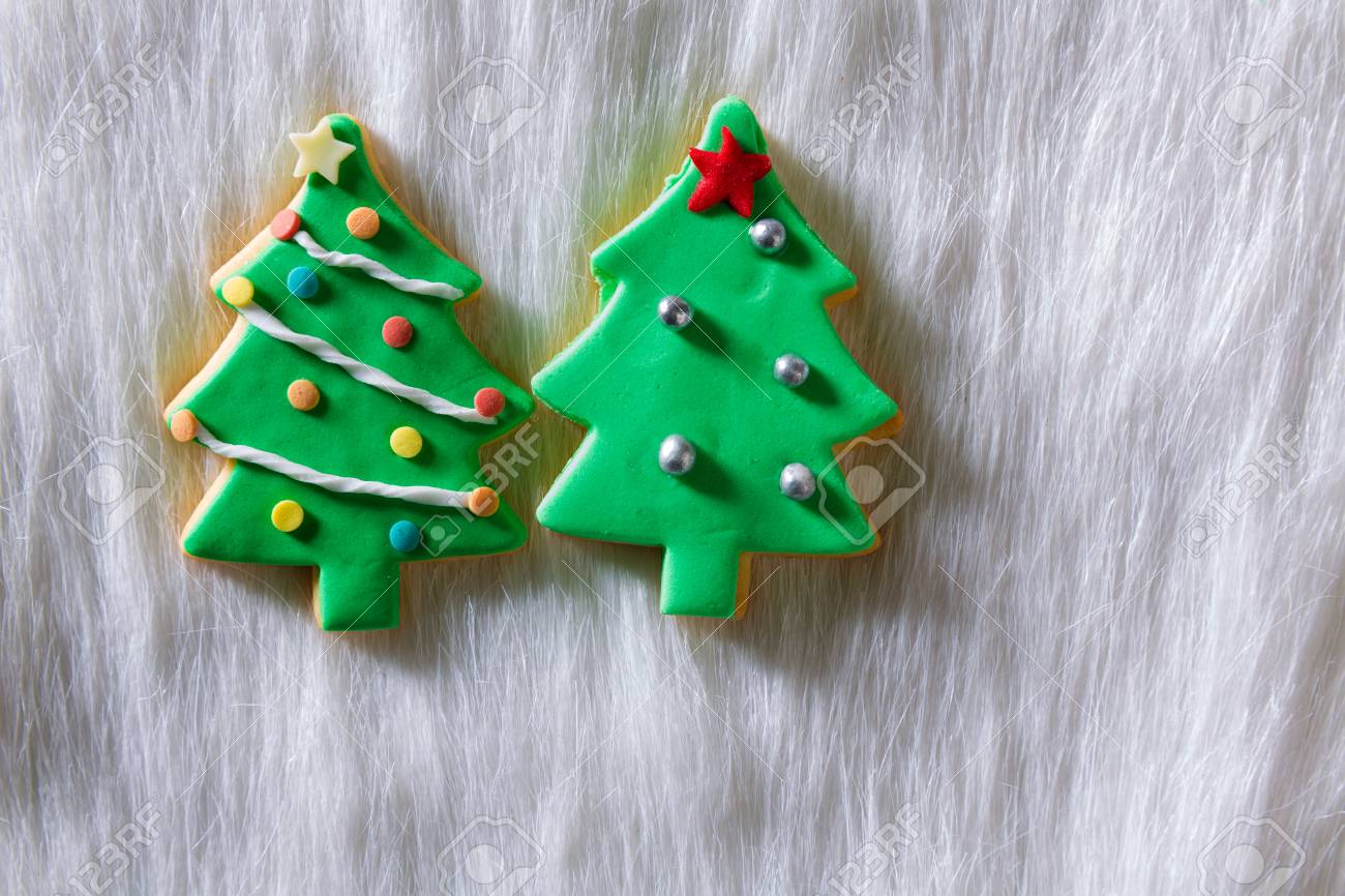 Christmas Cookies Xmas Tree Shape On White Fur Background