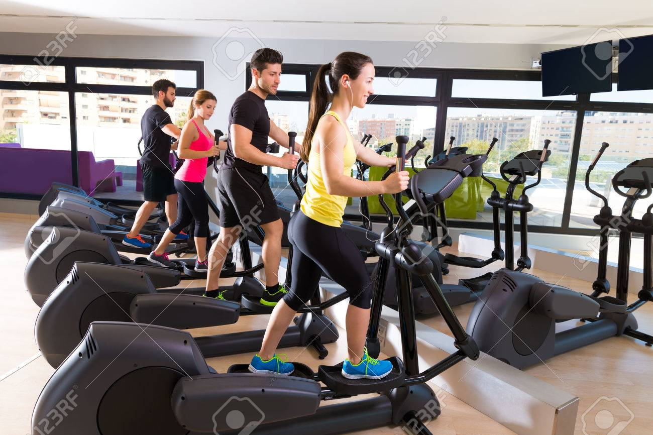 Aerobics Elliptical Walker Trainer Group At Fitness Gym Workout Stock Photo