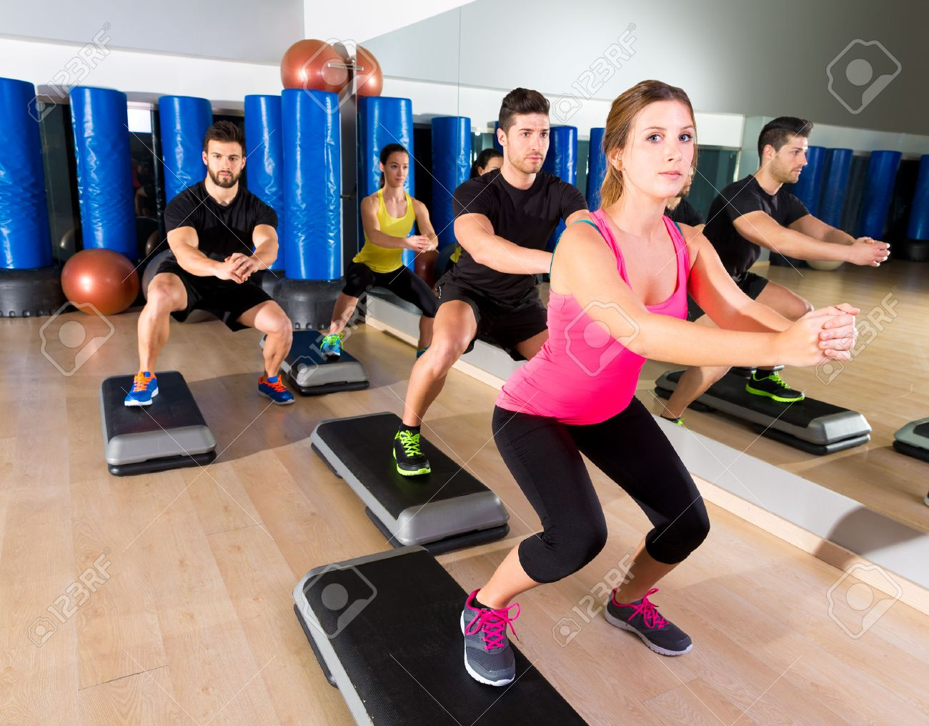 Cardio Step Dance Squat People Group At Fitness Gym Training Workout Stock Photo
