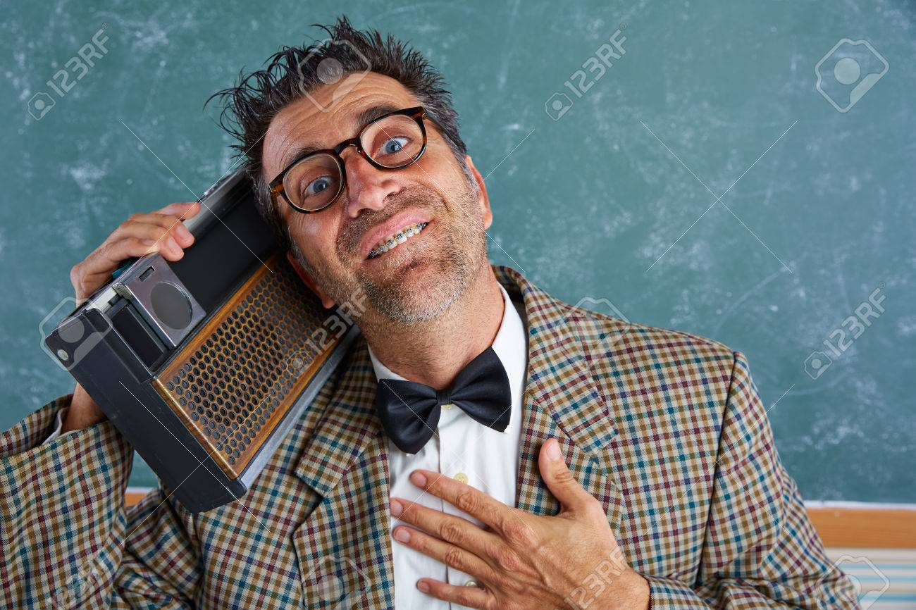 83df38e49f5b Nerd silly retro teacher man with braces and vintage radio and crazy  expression Stock Photo -