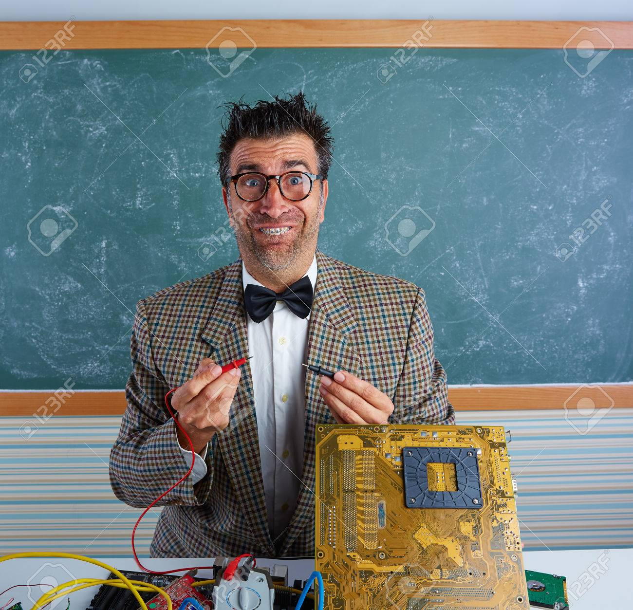 a1c56e16ba23 Nerd electronics technician retro teacher silly expression working in pcb  Stock Photo - 45321222