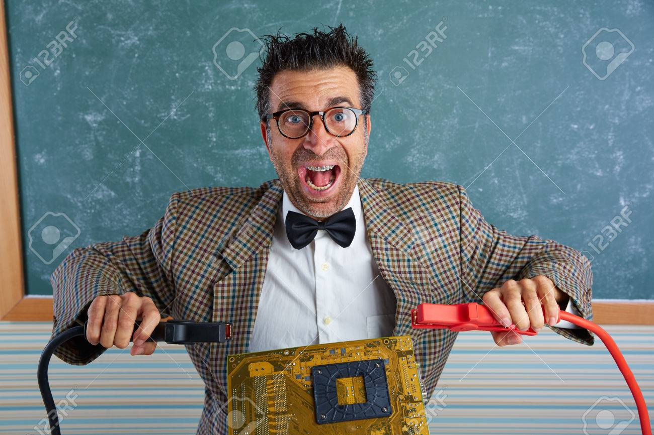 72dd65eebd97 Nerd electronics technician retro teacher silly expression with big battery  clamps in pcb Stock Photo -