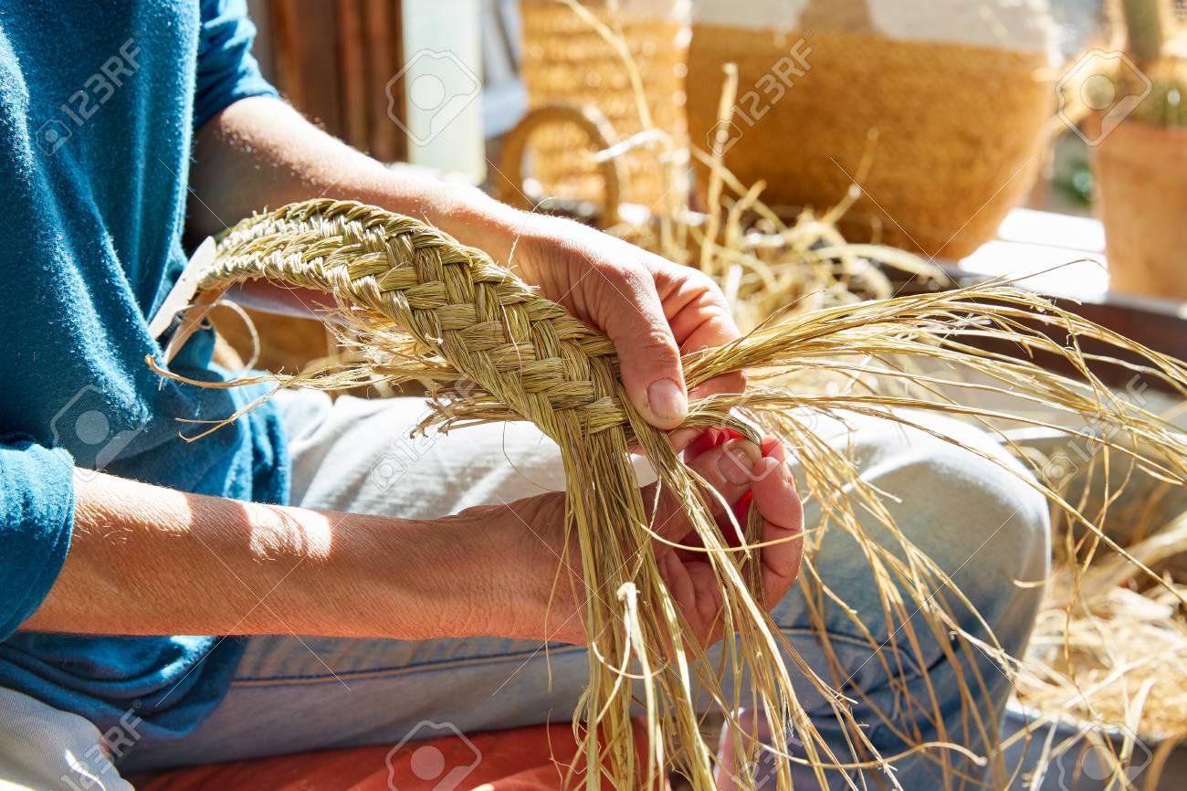 Esparto halfah grass crafts craftsman hands working - 77712054