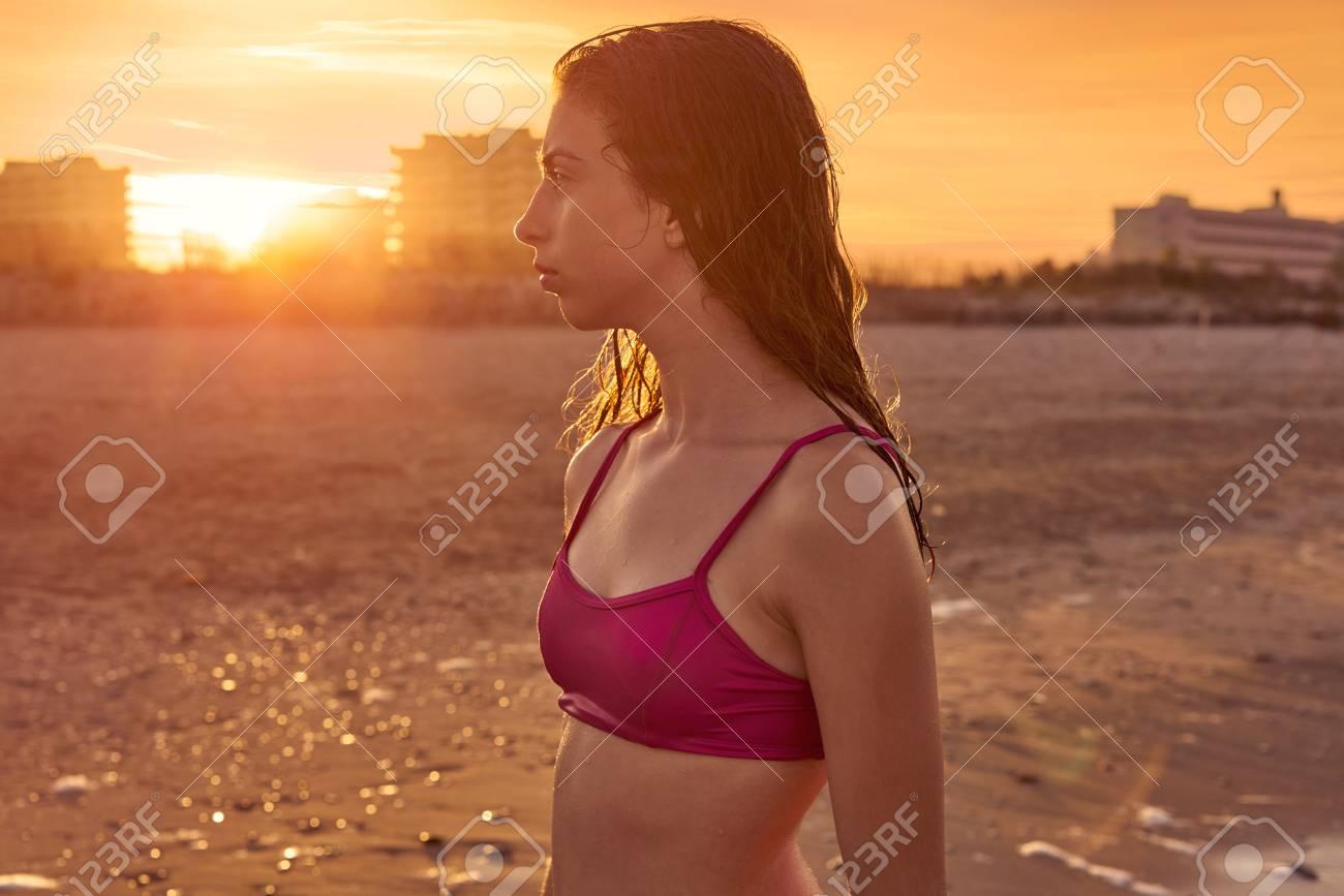 Bikini girl in the beach sand at summer Mediterranean - 109608224