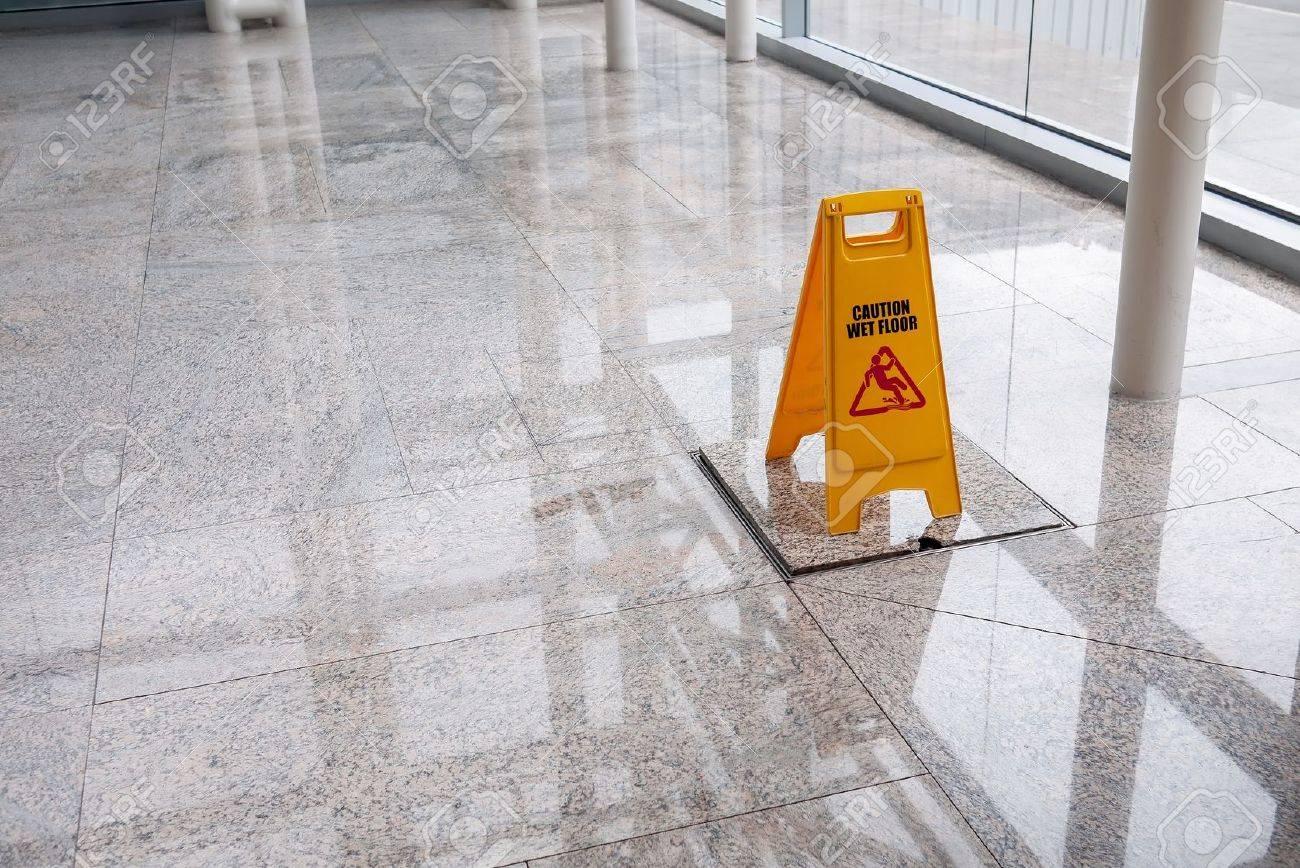 wet floor sign on lobby floor - 21582546
