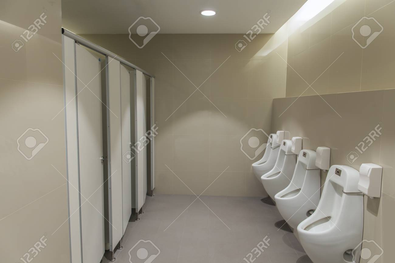 Tiles Wall In The Toilet Of Man With Toilet View By Urinals And Stock Photo Picture And Royalty Free Image Image 63413751