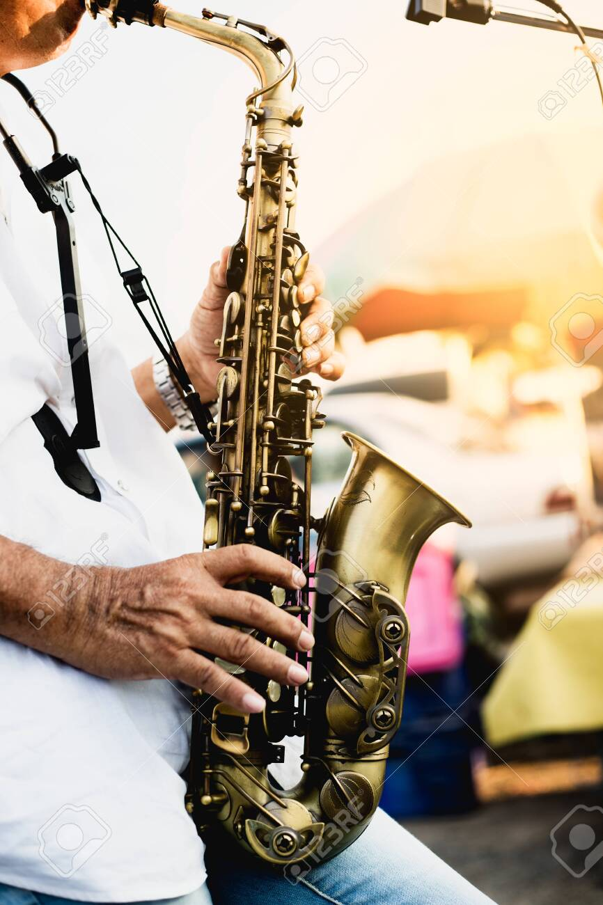 jazz musician playing the saxophone - 147222564