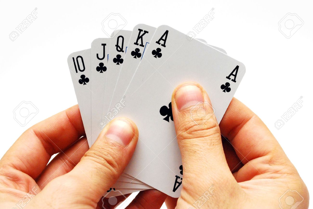 A hand holding five cards in a game of poker isolated - 6222402