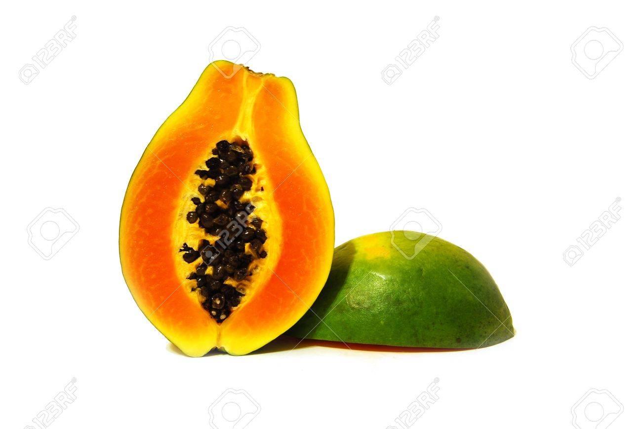 two nice tasty halves of papaya on white background - 6481756