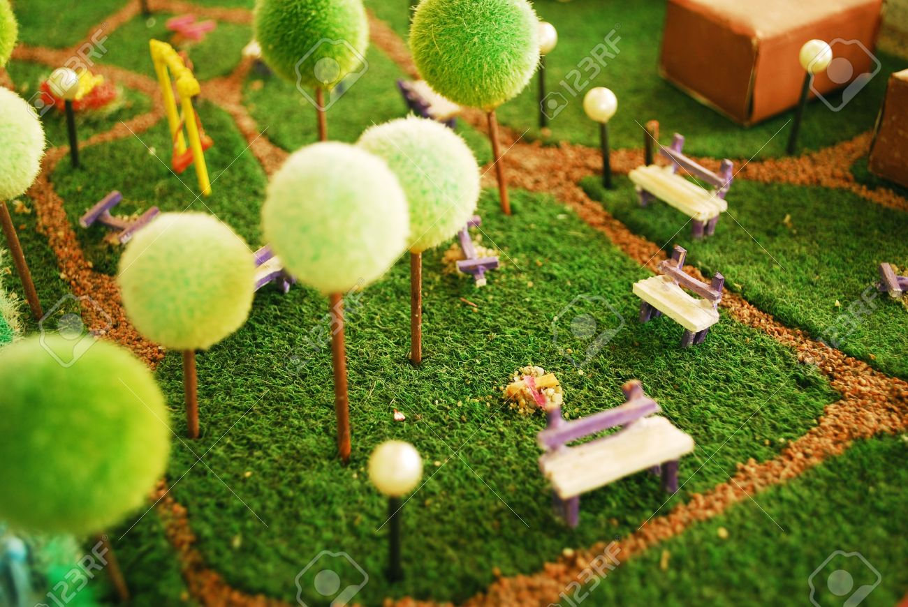 detail of a garden maquette with trees and playground - 6874690