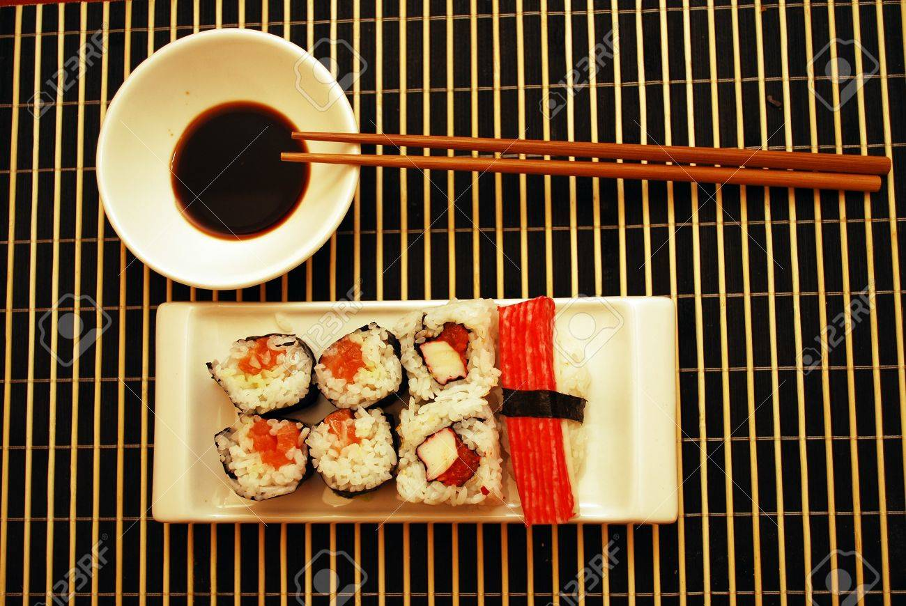 Seafood traditional sushi and rolls on the white dish. - 8070062
