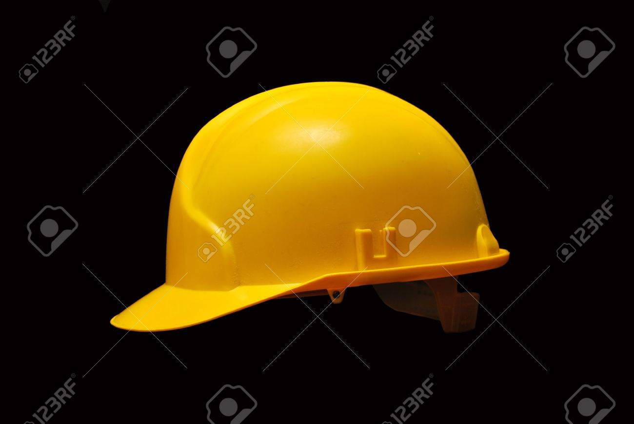 Image of a yellow helmet isolated on black background - 9111406