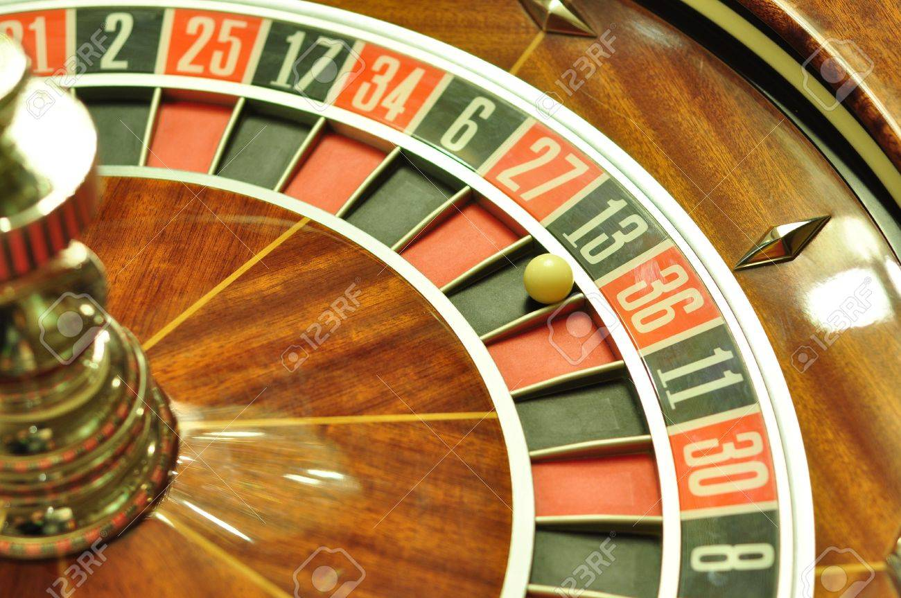 image with a casino roulette wheel with the ball on number 13 - 11326999