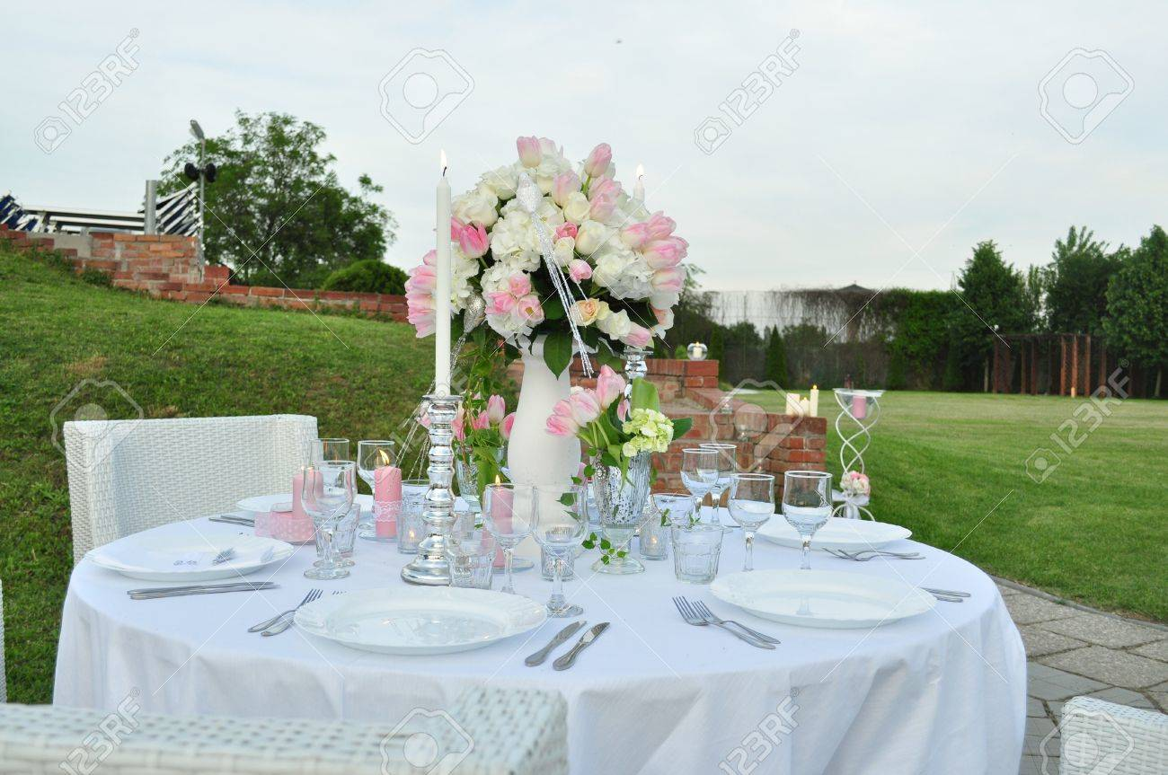 image of a romantic outdoor table prepared for dinner with flowers - 15195883
